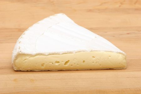 Brie cheese on cutting board