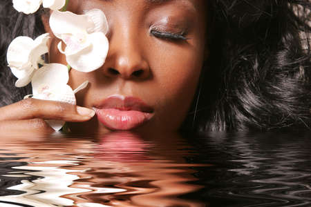 Beautiful sexy black woman with orchid Stock Photo - 2193473