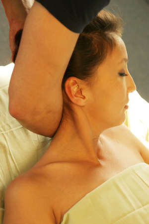 deeptissue: Massage therapist giving neck massage Stock Photo