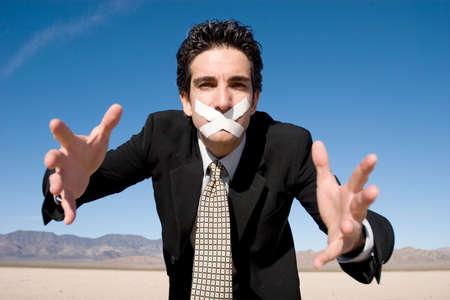 duct: Hombre de negocios con una cinta adhesiva en su boca