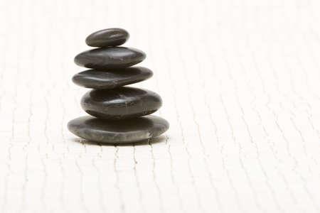 Stack of black spa stones Фото со стока