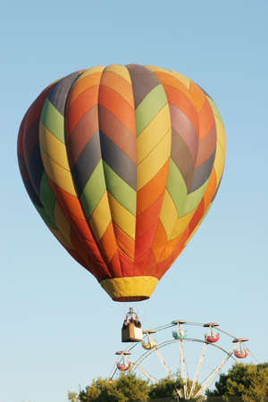 Colorful hot air balloon and ferris wheel