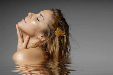 Beautiful sexy woman in water