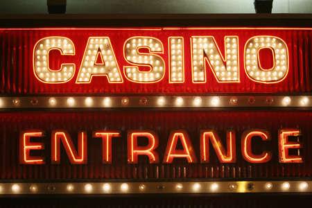 Neon lights casino entrance sign photo