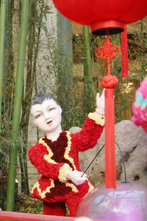 Chinese doll celebrating the new year photo