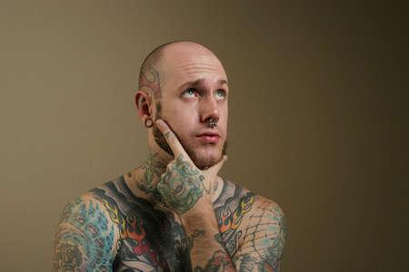 nosering: Sexy tattooed man portrait