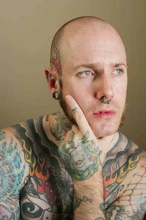 nosering: Tattoo man thinking Stock Photo