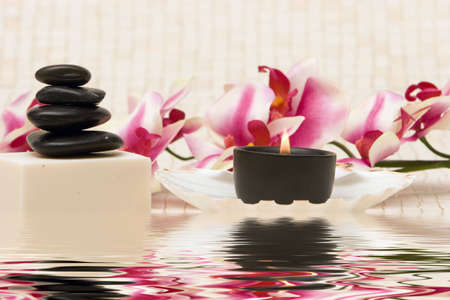 rejuvenate: Spa stones, candle, soap and orchid Stock Photo