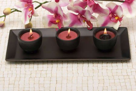 Aromatherapy candles and pink orchid Stock Photo - 2201287