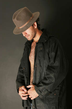Attractive man with hat and trenchcoat photo