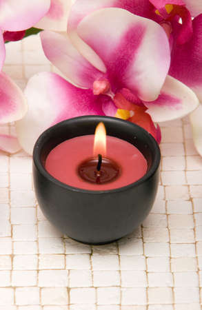 Aromatherapy candle and pink orchid Stock Photo - 2283661