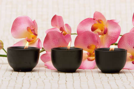 Aromatherapy candles and pink orchid Stock Photo - 2291792