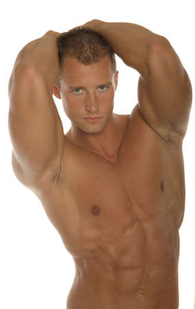 muscular male: Sexy body builder flexing his muscles Stock Photo