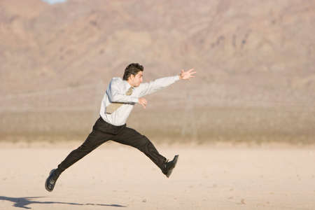 Happy businessman jumping in air Stock Photo - 2312717