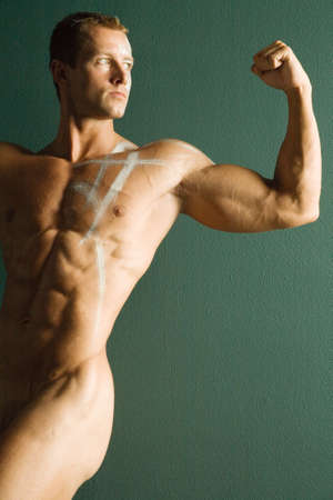 naked abs: Sexy body builder flexing his muscles Stock Photo