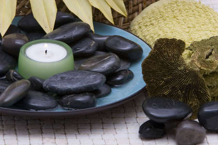 revitalize: Spa stones and candle in a bowl Stock Photo