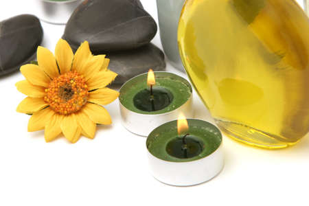Spa oil, daisy and candles
