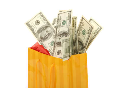 holiday spending: Shopping bag and money isolated on white background