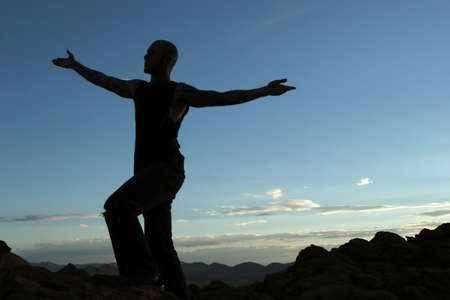 Silhouette of a man on mountain top photo