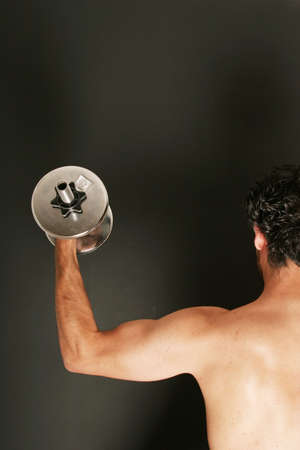 Man working out with dumbbell Stock Photo - 2336478