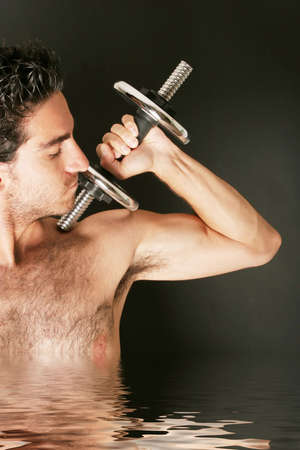 Sexy body builder working out with dumbbell Stock Photo - 2336629