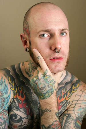 nosering: Portrait of a tattooed man