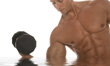 Sexy body builder working out with dumbbell Stock Photo - 2336728