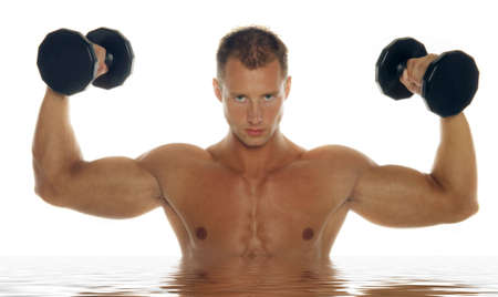 Sexy body builder working out with dumbbell Stock Photo - 2336623