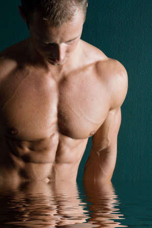 sixpacks: Sexy body builder flexing his muscles Stock Photo