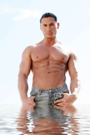 Sexy body builder in blue jeans Stock Photo - 2336543