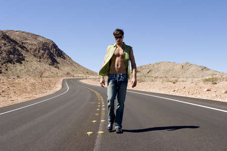 washboard: Sexy man standing on empty road