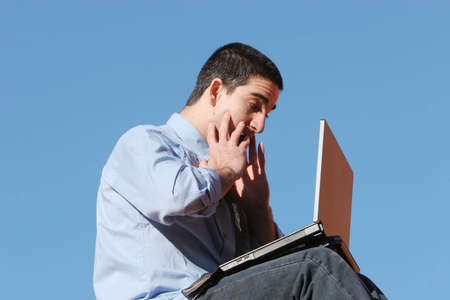 Young businessman working on his laptop Stock Photo - 2348147