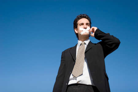 Businessman with a duct tape on his mouth photo