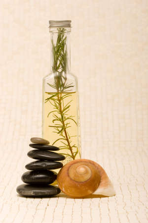 Essential oils and massage stones Stock Photo