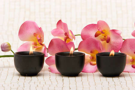 Aromatherapy candles and pink orchid Stock Photo - 2347413