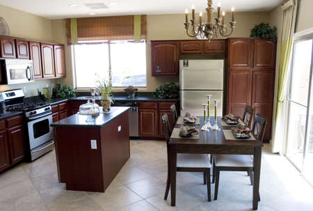 Modern kitchen and dining table photo