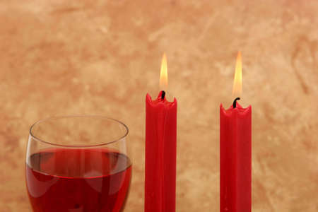 Glass of red wine and candles Stock Photo - 2347378