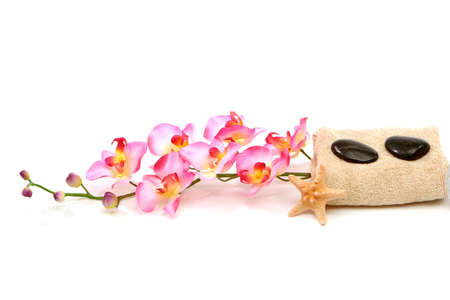 Spa towel, starfish, massage stones and pink orchid Stock Photo