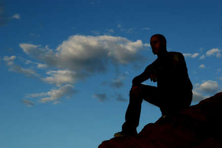 top: Silhouette of a man on mountain top Stock Photo