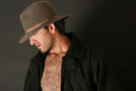 Attractive man with hat and trenchcoat Stock Photo - 2370105