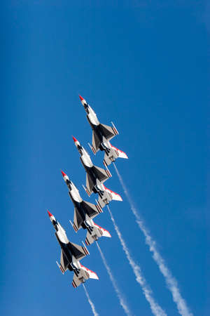 F-16 Thunderbird jets flying in formation photo