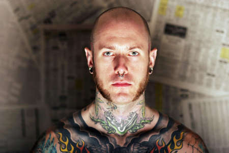 Young man covered in tattoo photo
