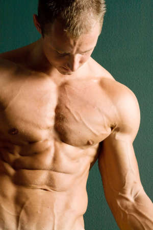Sexy body builder flexing his muscles Stock Photo - 2370401