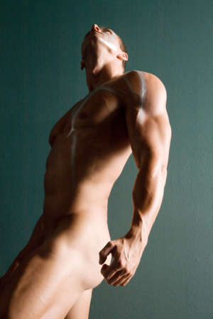 washboard: Sexy body builder flexing his muscles Stock Photo