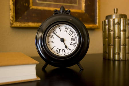 nightstand: Decorative clock on the nightstand