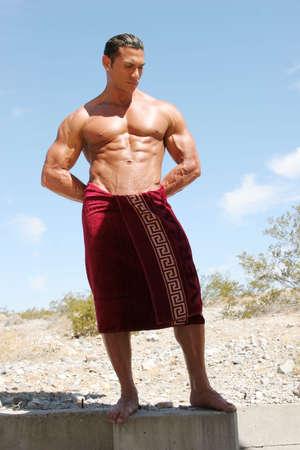 Muscular man in red towel