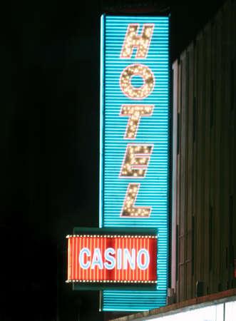 Neon light casino and hotel sign photo
