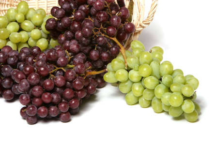white zinfandel: Red and green grapes in basket Stock Photo