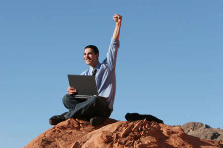 Ecstatic businessman with his laptop Stock Photo - 2714426