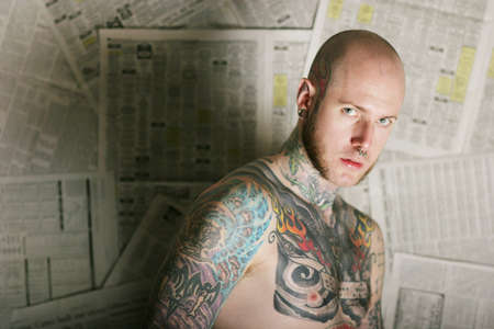 nosering: Tattoo man in front of newspapers